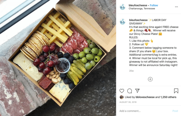 Box of food with cheese, meat, cherry, raspberry, nuts, etc for Labor Day Instagram Contests