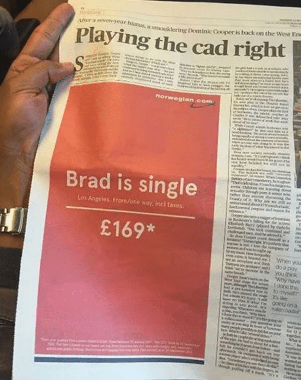 Newspaper article about hollywood Brad is single in pink background
